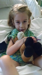 "Callie and ""Foxy,"" her favorite stuffed animal, before heading home."